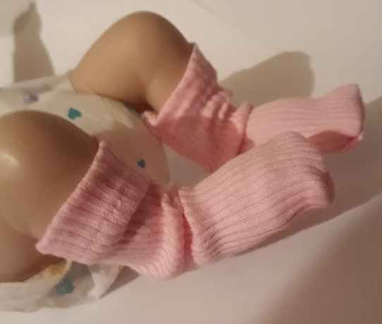 tiny baby socks infant miscarriage at 20 weeks funeral service babypink